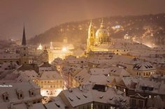 Prague, covered with a white snow blanket, on a magical wintry night.