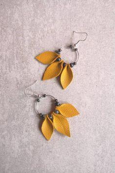 Yellow leather earrings, sunflower earrings, petal earrings, flower earrings, bo… – Johanna Weiß - Hand Made Diy Leather Earrings, Diy Earrings, Flower Earrings, Statement Earrings, Handmade Leather Jewelry, Yellow Earrings, Earrings Handmade, Hoop Earrings, Leaf Earrings