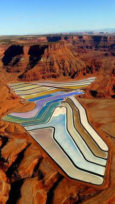 The Pastel Desert Pools of Utah. Man-made 'Potash evaporation ponds punctuate Utah's reddish-brown desert landscape, adding a touch of the bizarre to an otherwise barren region.' #travel #world #wonders