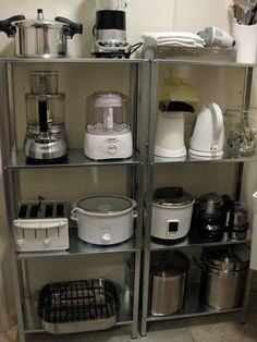 "I so ""NEED"" these shelves in my kitchen for all my small appliances.Organize small appliances on open shelving units - would be great to put in the pantry to reduce the look of clutter around the kitchen. Steel shelves are from Ikea. Ikea Kitchen Shelves, Ikea Shelves, Kitchen Pantry, Kitchen Appliances, Small Appliances, Kitchen Cabinets, Storage Shelves, Kitchen Small, Kitchen Gadgets"