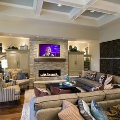 Love the ceiling - greys' adding depth! Love the stone around the fireplace and TV above.!