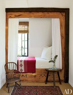 A child's guest room features a chalet-style box bed that has been nicknamed the Heidi Nook | archdigest.com