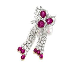 STAR RUBY AND DIAMOND BROOCH, VAN CLEEF & ARPELS Composed of three oval cabochon star rubies, each amid a floral frame enhanced by marquise-shaped, brilliant-cut and baguette diamonds, suspending brilliant-cut diamond fringes, each anchored by an oval cabochon star ruby, the rubies and diamonds together weighing approximately 25.00 and 10.00 carats respectively, mounted in 18 karat white and yellow gold, signed.