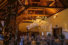Love the effect of the light canopy and paper shades in the tithe barn at Ufton Court.