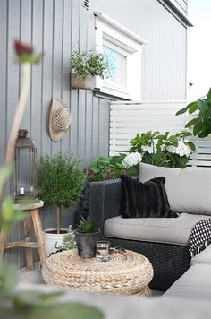 Neutral colors and lots of greenery for this stylish patio