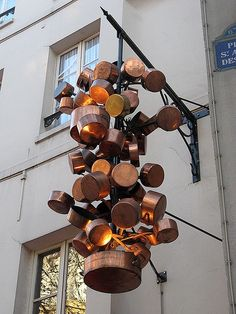 Lighting from copper bottomed pans. Rive Gauche Restaurant, Paris
