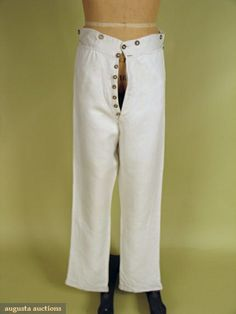 """GENT'S WHITE LINEN TROUSERS, AMERICA, c. 1830 Linen twill, twenty four metal buttons stamped """"Warranted Not To Cut"""", including buttons sewn inside pants hem, long slim legs, all hand stitched, red cross stitched """"I.G."""" in waist lining"""