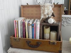 Cute way to use a vintage suitcase, mini-bookshelf/display area. (A Southern Belle with Northern Roots)