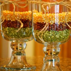 Looking to DIY your fall centrepieces? Find a few hurricane vases (or any vase of your liking) and fill them with kernels, small red beans and split peas, just the way My Heart's Desire did for these autumn-inspired decorations.