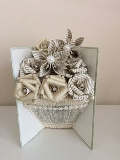 Folded book art vase shape with paper flowers                                                                                                                                                                                 More