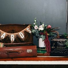 What a beautiful wishing well table for Kasey and Chris's wedding Vintage decor supplied by us It's hard to believe that typewriter is 100 years old and restored with love ❤️ Vintage Props, Vintage Decor, Prop Styling, Wishing Well, Typewriter, Wells, Restoration, Bridal Shower, Empire