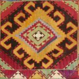 """SE161 CONTAINER FOR YURT DECORATIONS DASHT-I-KIPCHAK UZBEK PEOPLE possibly LAKAI early 20thcentury front panel is silk cross-stitch embroidery on cotton, sides are cotton with fragments of a Tashkurgan (Afghanistan) suzani, bottom and back are made of a wool kilim; 20""""H X 43W X 10""""D"""
