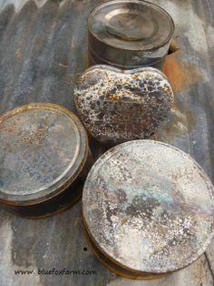 http://www.bluefoxfarm.com/making-metal-look-old.html - loving rustic metal tins?  Me too!