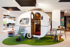 8 Of Google's Craziest Offices | Co.Design | Google Amsterdam HQ designed by local studio D/Dock. 1960s caravans serve as meeting rooms, complete with lawn chairs and fake grills.
