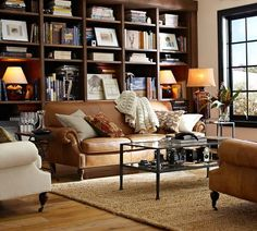 Warm, cozy, inviting. Lots of browns and ivories - works well with lots of natural light. love how the bookshelves are decorated.Great space!