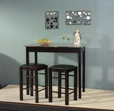 With its faux marble surface and rich espresso finish, this counter-height dining set makes a smart pick for a space-conscious kitchen ensemble. It's the perfect spot to enjoy coffee and the paper on weekday mornings, and doubles as a stylish way of serving appetizers at your next get-together.