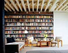 huge industrial bookcase in Ike Kligerman Barkley Tribeca loft | Casasugar: A Butter Warehouse Turned Tribeca Loft