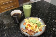 This is what I call a breakfast of champions, my Paleo 21DSD Green Monster smoothie served with eggs, vegetables and yummy bacon