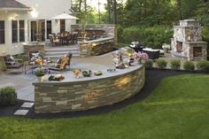 Outdoor space including a fireplace lower patio seating area raised patio seating area lighting and landscaping work. Backyard Seating, Backyard Patio Designs, Backyard Retreat, Backyard Landscaping, Patio Ideas, Landscaping Ideas, Pool Ideas, Backyard Ideas, Deck Seating
