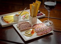 A cheese plate with charcuterie and a glass of 2009 Cru 32 Napa ~ 1313 Main ~ Downtown Napa Wine Bar. Chronicle / SF