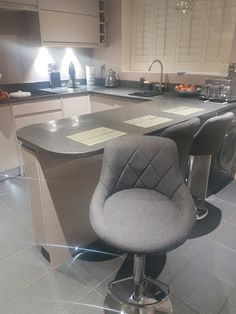 Our Fabric Charcoal Grey Flo Bar Stools #barstool #stools #kitchens #modern #modernhome #modernkitchen For further details please visit the link below https://www.lakeland-furniture.co.uk/flo-fabric-bar-stool-charcoal/