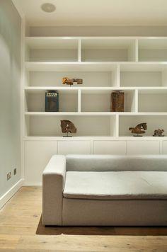 Portobello Road, Notting Hill by Ardesia Design. Custom made shelf unit with storage below #living #room #custom #made #storage #shelf #wide #sofa #wooden #floor #antique #accessories