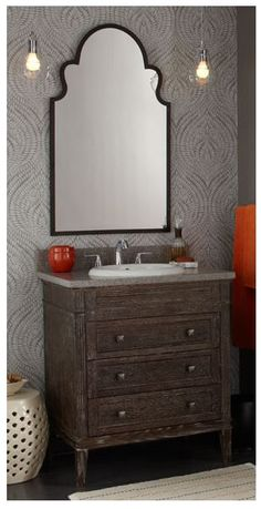 Let our expert consultants help you recreate this look today! Featured is the @ronbowcorp Laurel vanity, a #Mirabelle vitreous china #sink with a Mirabelle Provincetown polished chrome #faucet, gorgeous #CapitalLighting mini #pendants, and our look is completed with a Uttermost Brayden Arch mirror for an absolutely stunning Powder Room!