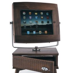 Check out this cool iPad accessory stand called the V-luxe.  A kickstarter campaign back in 2010 helped designer Paula Patterson launch a line of handcrafted accessory stands for the iPad, iPhone and iPod Touch.