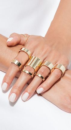 Stacked Gold Rings with a white mani -- love this!