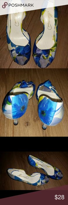 Blue and white median heels size 7 It was used only 3 times in great condition so cute and ready for that special night or that special event. Michelangelo Shoes Heels