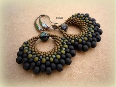 Earrings by IrenaK. Most of the beautiful and modern stitched beadwork seems to come from Eastern Europe and Russia.