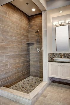 20 Amazing Bathrooms With Wood-Like Tile modern shower with wood tile Bathroom Tile Designs, Bathroom Floor Tiles, Wood Bathroom, Bathroom Interior, Bathroom Ideas, Master Bathroom, Bathroom Showers, Tile Showers, Bathroom Cabinets