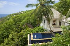 Perched between natural vegetation overlooking the exquisite beaches of the Indian Ocean, the Banyan Tree Seychelles resort lays lush tropical mountain greenery at your feel just below the carefully designed villas. Located on the south-western coastline of Mahé Island, this collection of 60 beautifully welcoming Creole-style villas await guests with their elegant and bright interiors and swimming pools guarded by imposing palm trees.