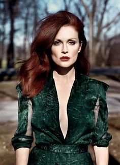 Julianne Moore. Long red hair and stylish V cleavage green dress.
