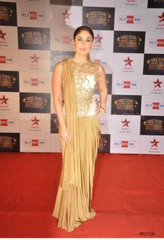 #CelebrityReplica Follow your favorite celebrity and their attire. Look beautiful like Kareena in this golden printed Saree. Find selected range of bollywood dresses on Ethnic Station. To know more click http://www.ethnicstation.com/women/celebrity-replica/kareena-kapoor-in-golden-printed-saree-PF2726
