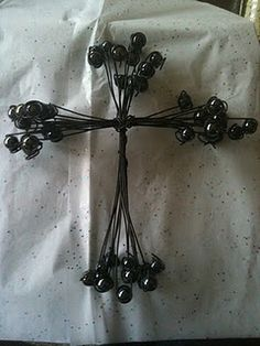 bailing wire and marble Cross.  Very easy project.