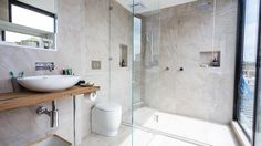 The boys went for opulent luxury in their ensuite with the enormous sand coloured natural patterned tiles.