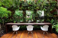 Modern Whites and wood tones mixed in for contrast - Rainforest seating