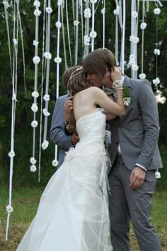 I want an outside wedding with lots of hanging down streamers and stuff. Especially white lights in the trees