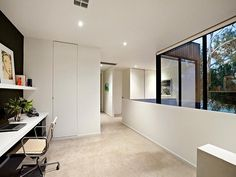 Awesome Robert Simeoni Building of Natural Modern House: Cozy Contemporary Melbourne Home Home Office With White Wall Desk With Shelving Abo. Melbourne Suburbs, Melbourne House, Home Office Design, House Design, Flat Roof House, Wood Cladding, Stylish Chairs, Street House, Australian Homes