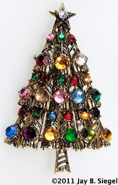 I have this vintage Hollycraft (c) Christmas tree pin. It was my grandmother's. :-)