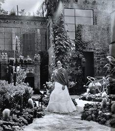 Frida Kahlo in her garden at Casa Azul, 1951