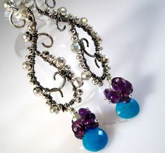 Handmade sterling silver, turquoise, and amethyst earrings.
