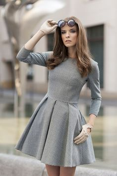 I love everything about this. The lines of the dress, the flare of the skirt, the color, the way her hair is curled, and the glasses. Imagine this with a big yellow patent clutch or something. (via http://www.glamzelle.com)