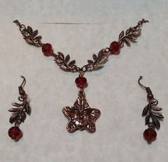 Antiqued Copper Red Crystal Leaf Man Necklace And by Ziplily