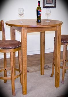 """Round Pub Table Sedona Rustic Oak Width: 36"""" Height: 42"""" Depth: 36"""" This 4-Leg Pub Table adds personality to any dining or entertaining space. Featuring a 42"""" tall rustic oak base with tapered legs, it is an ideal addition to a bar area."""