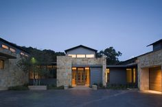 The horizontal forms of this stone contemporary are from Dick Clark Architecture