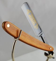 "Dovo 115 5861 Diamant Straight Razor, 5/8 Inch Black Full Hollow Ground Carbon Steel Blade, White Ebonywood Handle, Germany. Gorgeous, top of the line Diamont model with 5/8"" hollow ground gold etched Black Carbon Steel blade.  This style is the finest straight razor edge produced by Dovo, and it is very delicate and extremely sharp. The handle is excellent quality White Ebonywood. The blade is 5/8"" wide."