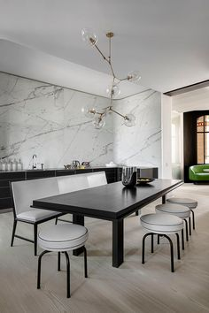 marble feature wall, lindsey adelman chandelier, banquette bench