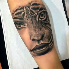 Half woman/half tiger face tattoo for forearm.